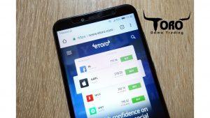 eToro trading on the phone